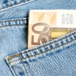 Banknote in pocket - Stock Photo
