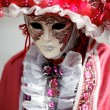 Stock Photo: Carnival mask under pink costume