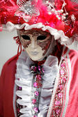 Carnival mask under pink costume — Stock Photo