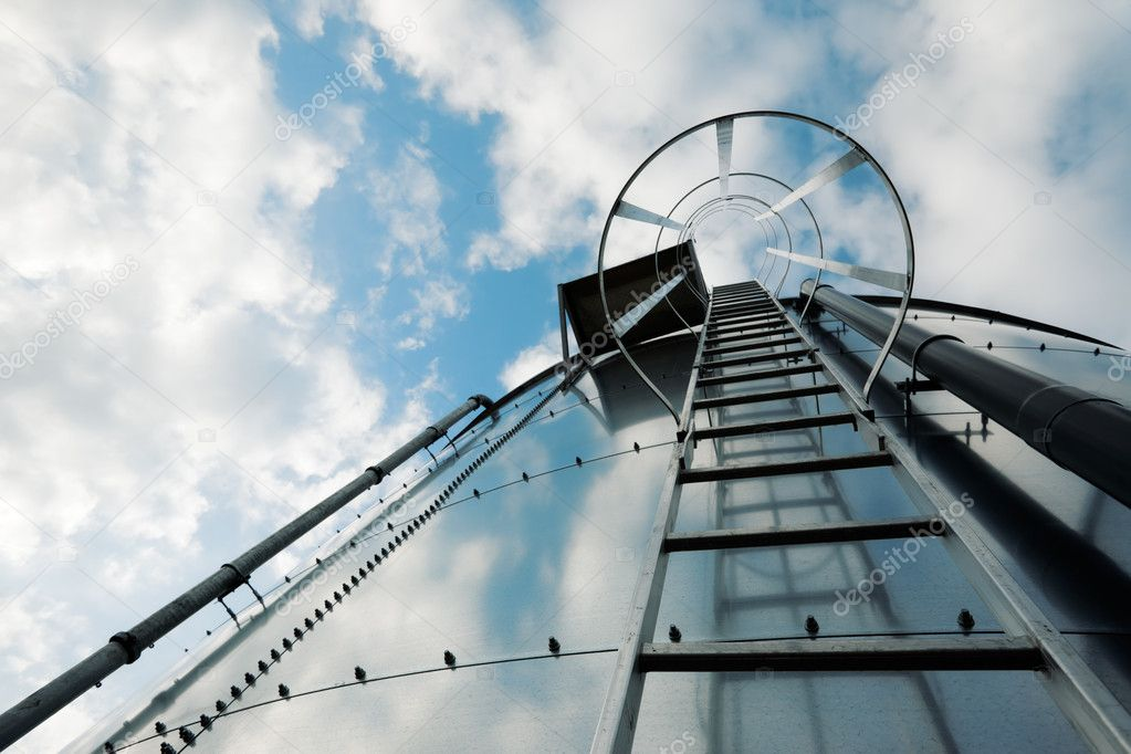 Low-angle shot of ladder on tank refinery. — Stock Photo #2409545