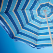 Parasol against deep blue sky — Stock Photo