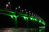 Viaduct under green lights — Stock Photo