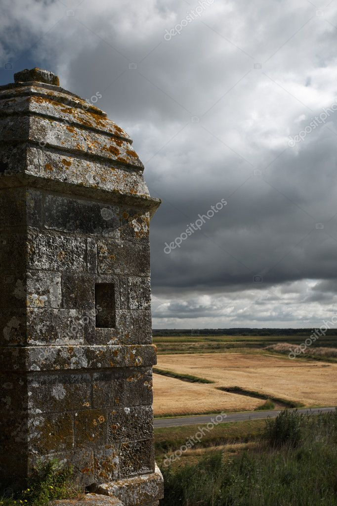 Moody sky on fields and medieval turret (Brouage / Charente Maritime) — Stock Photo #2416771