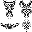 Stock Vector: Set of 4 tribal tattoos