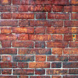 Graffiti Filled Red Brick Wall. - Stock Photo