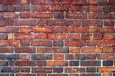 Graffiti Filled Red Brick Wall. — Stockfoto