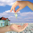 Lady hands giving key on 3d house money - Stock Photo