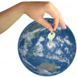 Woman hand giving the key of the world — Stock Photo