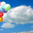Colored party balloons against blue sky — Stock Photo