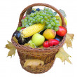 Wicker basket with autumn fruit - Stock Photo