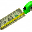 Stock Photo: Crisis: measuring tape over us dollar