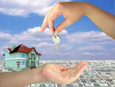 Lady hands giving key on 3d house money — Stock Photo