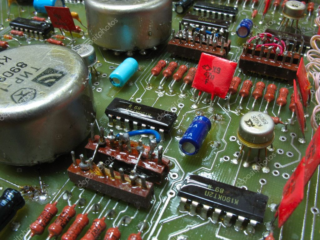 Old circuit board from the 80th with colored electronic pieces  Stock Photo #2089325