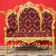 Ornated golden sofa furniture — Stock Photo
