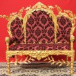 Ornated golden sofa furniture - Foto Stock