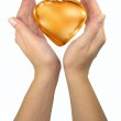 Human lady hands holding golden heart — Stock Photo