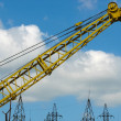 Building crane detail against blue sky - Stock Photo