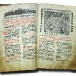 Aged old religious opened book — Stock Photo