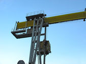 Industrial crane detail against blue sky — Stock Photo