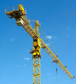 Yellow building crane over blue sky — Stock Photo