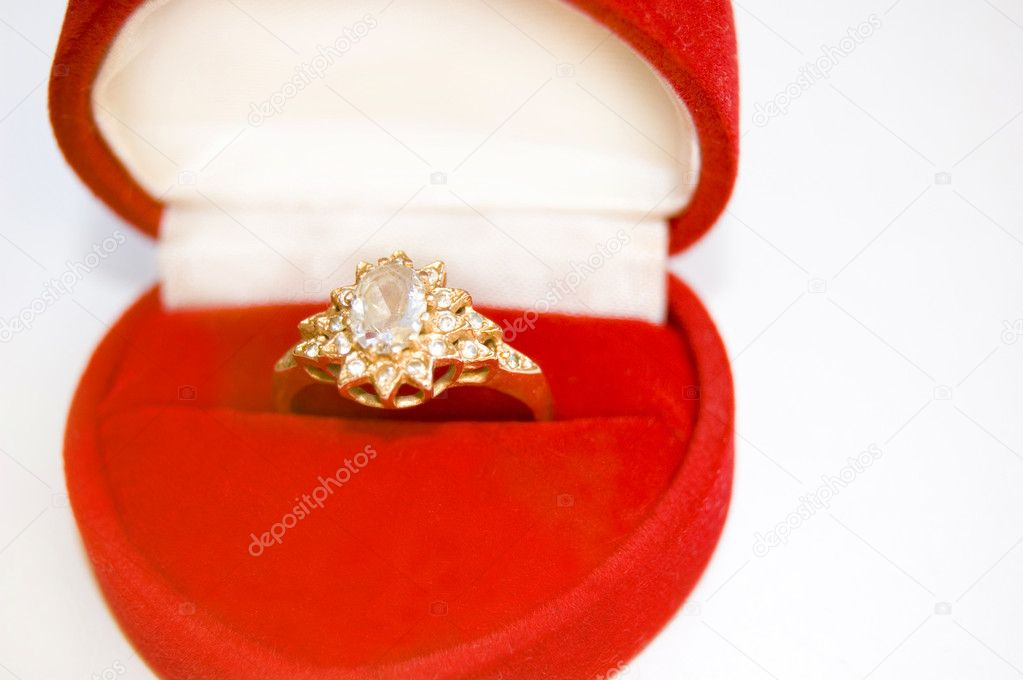 Golden ring with diamond lies in box about form of heart. — Stock Photo #2076879