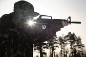 Soldier, his Rifle and the Sun — Stock Photo