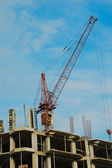Tower crane and house-building — Stock Photo