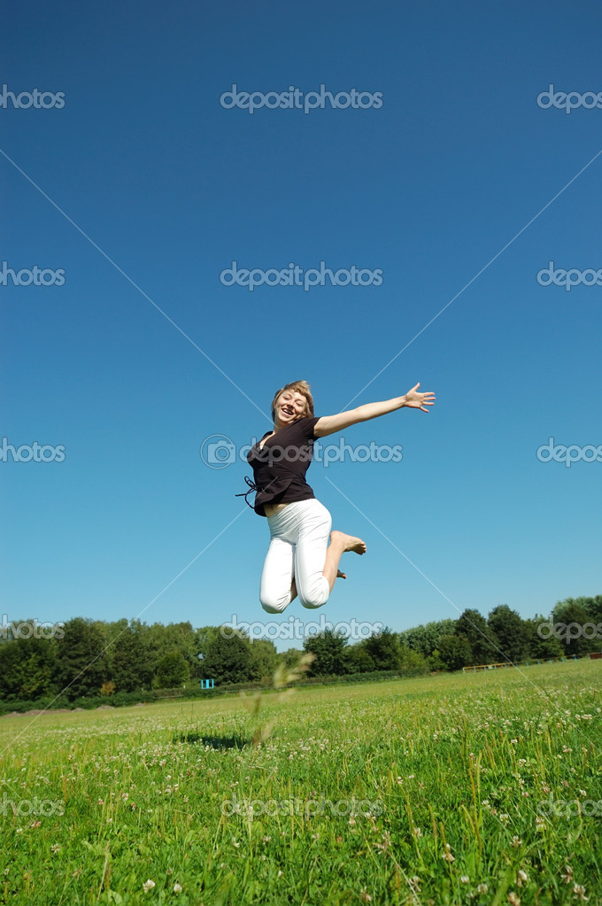 Jumping young happy girl — Stock Photo #2501563