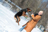 Happy girl playing with dog — Stock Photo
