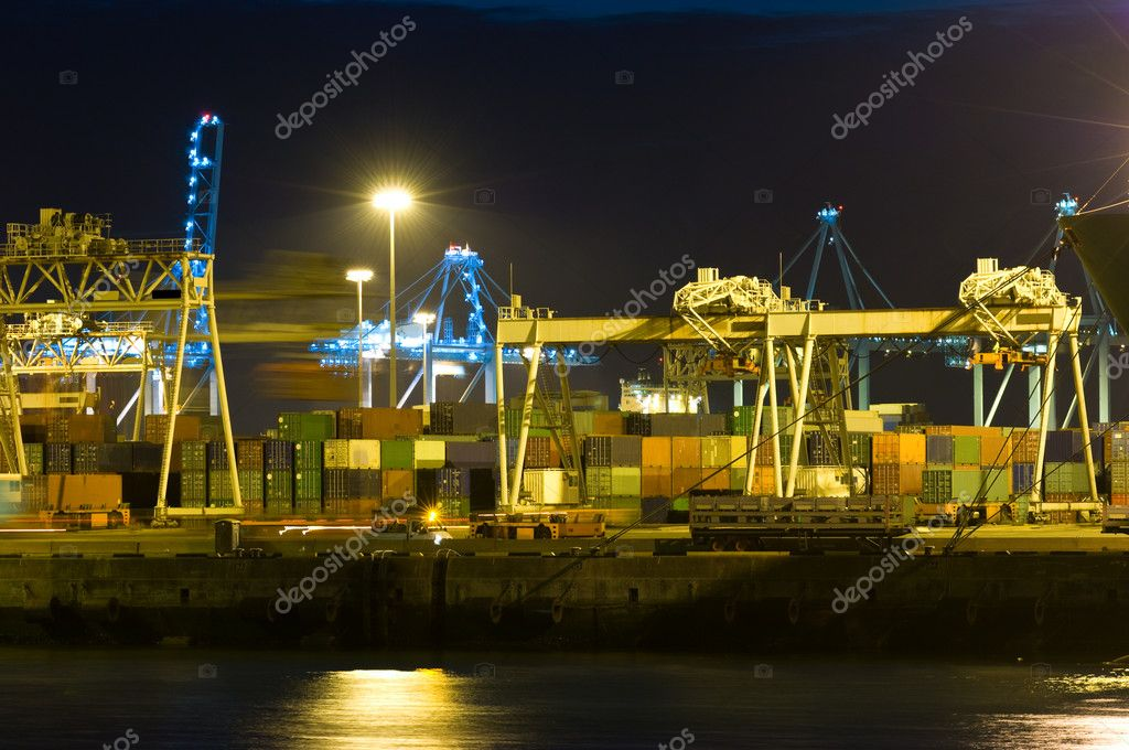 Various cranes and trolleys manipulating container logistics in a busy industrial harbor — Stock Photo #2077855