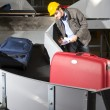 Foto Stock: Checking luggage