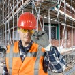 Saluting construction worker - Foto Stock