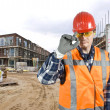 Saluting construction worker - Stockfoto