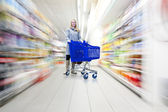 Woman in supermarket — Stock Photo