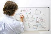 Engineer at whiteboard — Stock Photo
