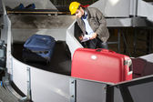 Checking luggage — Stockfoto