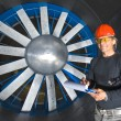 Foto Stock: Smiling Engineer in Windtunnel