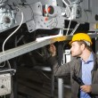 Maintenance engineer at work - Stock Photo
