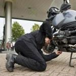 Motorist, checking the oil level — Stock Photo #2090399