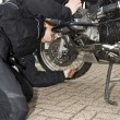 Checking the oil level of a motorcycle — Stock Photo #2090463