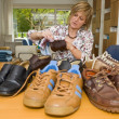 Polishing shoes - Stock Photo