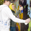 Two boys spray painting — Stock Photo