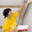 Painting woman — Stock Photo
