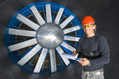 Smiling Engineer in a Windtunnel — Stockfoto