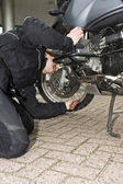 Checking the oil level of a motorcycle — Stock Photo