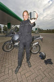 Motorcyclist showing a blank steel can — Stock Photo
