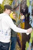 Two boys spray painting — Stockfoto