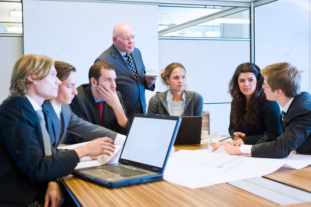 The youngest employee making a suggestion during a team meeting, and everybody, including the senior executive (boss) listens — Stock Photo #2098809