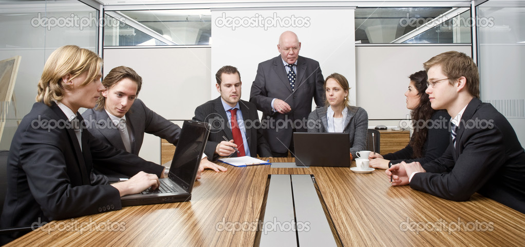 Seven in a cubicle, preparing for a management team meeting — Stock Photo #2098847