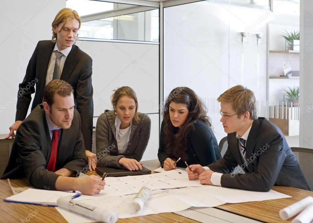 Five colleagues going over blue prints — Stock Photo #2099255